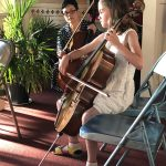 String instructor Jenny Huang-Dale watches as a young girl performs on her cello